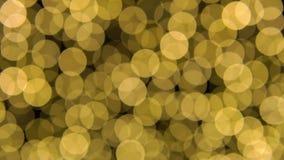 Τα αφηρημένα υπόβαθρα bokeh χρωματίζουν κίτρινος και χρυσός φιλμ μικρού μήκους