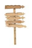 Τα βέλη των χαρτονιών σε μια ξύλινη θέση. Στοκ Εικόνα