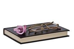 τα γυαλιά βιβλίων αυξήθη&kapp Στοκ Φωτογραφίες