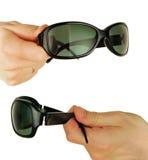 τα γυαλιά δίνουν γυναικείο Στοκ Φωτογραφία