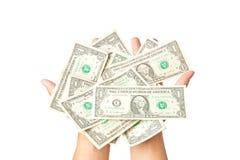 τα δολάρια ανασκόπησης δίνουν το λευκό Στοκ Εικόνες