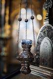 Τα εγκαύματα κεριών στην εκκλησία, λεπτομέρεια στοκ φωτογραφία
