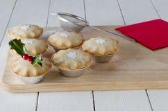 Τα εορταστικά Χριστούγεννα κομματιάζουν τις πίτες Στοκ Εικόνα