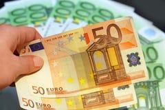 τα ευρώ δίνουν Στοκ φωτογραφία με δικαίωμα ελεύθερης χρήσης