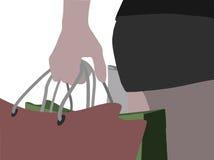 Τα θηλυκά χέρια που κρατούν αγορές τοποθετούν σε σάκκο ελεύθερη απεικόνιση δικαιώματος