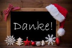 Τα καφετιά μέσα Danke καπέλων Santa πινάκων Χριστουγέννων σας ευχαριστούν Στοκ Εικόνες