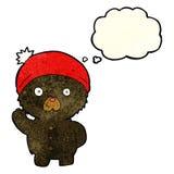 τα κινούμενα σχέδια που κυματίζουν μαύρο teddy αντέχουν στο χειμερινό καπέλο με τη σκέψη bubbl Στοκ εικόνες με δικαίωμα ελεύθερης χρήσης