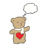 τα κινούμενα σχέδια teddy αντέχουν με την καρδιά αγάπης με τη σκεπτόμενη φυσαλίδα Στοκ εικόνες με δικαίωμα ελεύθερης χρήσης