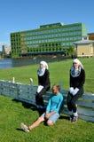 Τα κορίτσια έντυσαν στα κοστούμια Στοκ Εικόνες