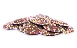 Τα κουμπιά σοκολάτας γάλακτος με ψεκάζουν τη διακοπή Στοκ εικόνες με δικαίωμα ελεύθερης χρήσης