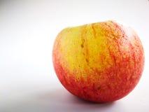 Τα κόκκινα και κίτρινα μήλα είναι το δέρμα της Apple Βλαστός με το phon Στοκ φωτογραφία με δικαίωμα ελεύθερης χρήσης