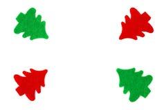 Τα κόκκινα και πράσινα χριστουγεννιάτικα δέντρα παράταξαν ως πλαίσιο Στοκ Εικόνες