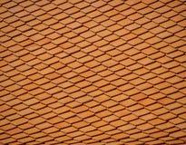 Τα κόκκινα κεραμίδια υλικού κατασκευής σκεπής Στοκ Φωτογραφία