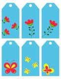 Τα λουλούδια και οι πεταλούδες. Ετικέτες Στοκ Εικόνα
