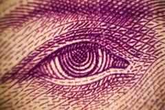 Τα μακρο πυροβοληθε'ντα κινηματογράφηση σε πρώτο πλάνο μάτια τραπεζογραμματίων χρημάτων των διάσημων μετρητών αξίας ανθρώπων της  Στοκ φωτογραφίες με δικαίωμα ελεύθερης χρήσης