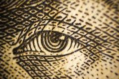 Τα μακρο πυροβοληθε'ντα κινηματογράφηση σε πρώτο πλάνο μάτια τραπεζογραμματίων χρημάτων των διάσημων μετρητών αξίας ανθρώπων της  Στοκ Φωτογραφία
