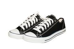 Τα μαύρα παπούτσια απομονώνουν σε ένα άσπρο υπόβαθρο Στοκ εικόνα με δικαίωμα ελεύθερης χρήσης
