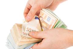 τα μετρώντας χέρια περιοχής απομόνωσαν τα μεγάλα χρήματα πέρα από το λευκό κειμένων σας Στοκ Εικόνα