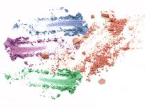 Τα μικτά χρώματα που συντρίβονται αποτελούν το καλλυντικό σκονών Στοκ Εικόνα