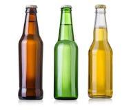 τα μπουκάλια μπύρας ανασκόπησης χρωματίζουν το ευγενές φωτογραφισμένο πορτοκάλι στούντιο κίτρινο Στοκ Εικόνες