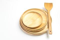 Τα ξύλινοι πιάτα ή οι δίσκοι με το βατραχοπέδιλο ή το φτυάρι απομόνωσαν το άσπρο υπόβαθρο στοκ φωτογραφία με δικαίωμα ελεύθερης χρήσης