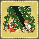 Τα παιδιά κρατούν το αλφάβητο παραμυθιού κινούμενων σχεδίων επιστολή Χ Χριστούγεννα Ο καρυοθραύστης και ο βασιλιάς ποντικιών από  Στοκ Φωτογραφία