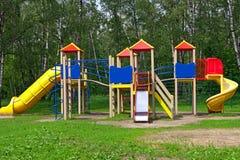 τα παιδιά σταθμεύουν την παιδική χαρά s Στοκ Φωτογραφία