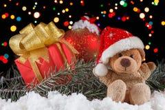 Τα παιχνίδια Χριστουγέννων teddy αντέχουν με τη διακόσμηση Έννοια Χριστουγέννων Στοκ Εικόνες