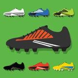 Τα παπούτσια ποδοσφαίρου καθορισμένα τα εικονίδια στο πράσινο υπόβαθρο ελεύθερη απεικόνιση δικαιώματος