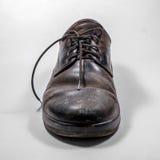 Τα παπούτσια των βρώμικων ατόμων που ψεκάζονται με ασπρίζουν Στοκ φωτογραφίες με δικαίωμα ελεύθερης χρήσης