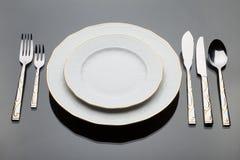 τα πιάτα που τίθενται τις &alph Στοκ Εικόνες