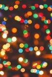 Τα πολύχρωμα αφηρημένα Χριστούγεννα ανάβουν τα πυροτεχνήματα Στοκ Φωτογραφίες