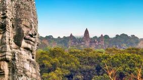 Τα πρόσωπα Angkor Wat, Siem πετρών μνημείων συγκεντρώνουν, Καμπότζη Στοκ Εικόνα