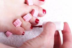 τα πόδια θηλυκών καρφιών γ&upsil Στοκ φωτογραφία με δικαίωμα ελεύθερης χρήσης