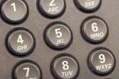Τα σύγχρονα ψηφιακά τηλεφωνικά κουμπιά IP με τους αριθμούς κλείνουν επάνω με την εκλεκτική εστίαση τονισμένος Στοκ Φωτογραφία