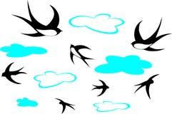 τα σύννεφα καταπίνουν στοκ εικόνα