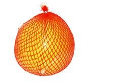 Τα φρούτα είναι pomelo στη συσκευασία στο πλέγμα για την αποθήκευση και τη μεταφορά Στοκ φωτογραφίες με δικαίωμα ελεύθερης χρήσης