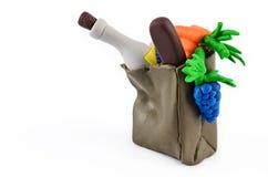 Τα φρούτα και λαχανικά στο παντοπωλείο τοποθετούν το πλαστικό άγαλμα σε σάκκο στοκ φωτογραφίες με δικαίωμα ελεύθερης χρήσης