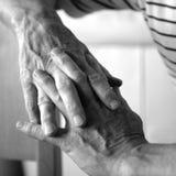 τα χέρια επανδρώνουν παλα&i Στοκ Εικόνες