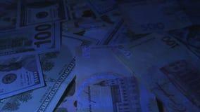 Τα χρήματα περιστρέφονται στον πίνακα μετονομασίες E Υπεριώδες φως φιλμ μικρού μήκους