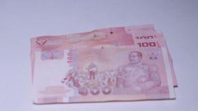 Τα χρήματα Ταϊλανδός είναι τραπεζογραμμάτιο είκοσι μπατ και εκατό μπατ και χίλια μπατ κ.λπ. φιλμ μικρού μήκους