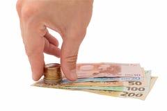 τα χρήματα χεριών παίρνουν Στοκ Φωτογραφία