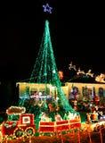 Τα Χριστούγεννα ανάβουν τις διακοσμήσεις Στοκ Φωτογραφία