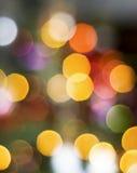 Τα Χριστούγεννα ανάβουν το υπόβαθρο Στοκ Φωτογραφίες