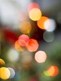 Τα Χριστούγεννα ανάβουν το υπόβαθρο Στοκ Φωτογραφία