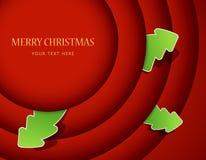 τα Χριστούγεννα διακριτικών περιβάλλουν το κόκκινο δέντρο Στοκ Εικόνες