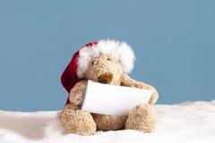 Τα Χριστούγεννα teddy αντέχουν με την κάρτα Στοκ φωτογραφία με δικαίωμα ελεύθερης χρήσης