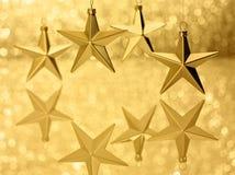 Τα χρυσά αστέρια Bokeh ακτινοβολούν υπόβαθρο Στοκ εικόνες με δικαίωμα ελεύθερης χρήσης