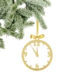 Τα χρυσά Χριστούγεννα ακτινοβολούν διακοσμητικό ρολόι στην κορδέλλα και το δέντρο branc Στοκ εικόνες με δικαίωμα ελεύθερης χρήσης