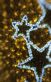 Τα χρυσά Χριστούγεννα το υπόβαθρο Στοκ Εικόνες